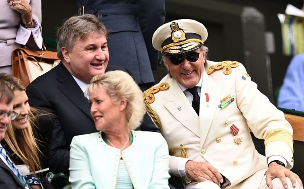 Romanian former tennis player Ilie Nastase (R) takes his seat in the royal boc on centre court on day seven of the 2015 Wimbledon Championships at The All England Tennis Club in Wimbledon, southwest London, on July 6, 2015.   ESTRICTED TO EDITORIAL USE  --   AFP PHOTO / LEON NEALLEON NEAL/AFP/Getty Images