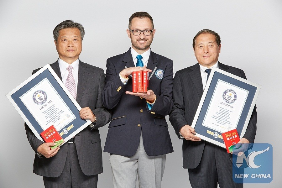 "(160413) -- LONDON, April 13, 2016 (Xinhua) -- Guinness World Records Senior Vice President Marco Frigatti (C), President of China Publishing Group Tan Yue (L) and President of The Commercial Press of China Yu Dianli display two certificates and some copies of Xinhua Dictionary in London, Britain, April 12, 2016. Guinness World Records Tuesday confirmed here that Xinhua Dictionary published by China's The Commercial Press is the ""most popular dictionary"" and the ""best-selling book (regularly updated)."" As of July 28, 2015 (last updated date), Xinhua Dictionary, the first modern Chinese dictionary since the foundation of the People's Republic of China on Oct. 1, 1949, has sold 567 million copies globally, Guinness World Records announced at the presentation ceremony in London. (Xinhua/Guinness World Records) (lyi)"