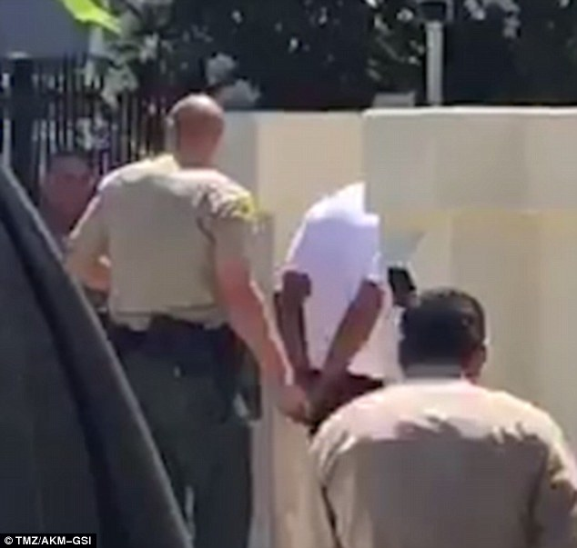 3696E5E100000578-3707832-Cuffed_Dr_Dre_was_patted_down_and_placed_in_handcuffs_after_Sher-a-20_1469492871573