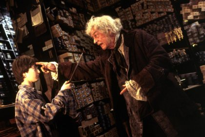 Harry Potter and the Sorcerer's Stone (2001) Daniel Radcliffe as Harry Potter and John Hurt as Mr. Ollivander  Film Frame