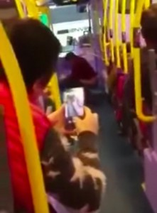 woman_appears_to_take_a_poo_on_middle_of_a_bus2_10044900