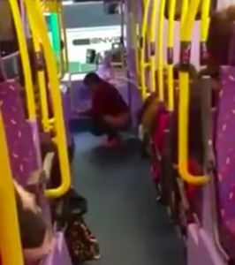 woman_appears_to_take_a_poo_on_middle_of_a_bus_12656900